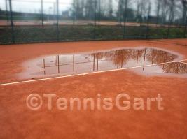 Teilsanierung Tennisplatz Teilüberholung Wasseransammlung Tennisplatzbau